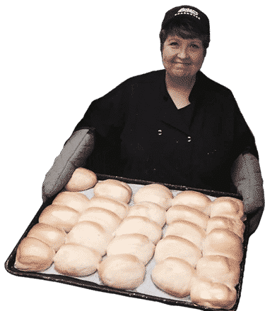 Brenda holds a pan of yeast rolls